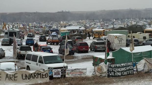 Winter has descended at the Oceti Sakowin Camp of water protectors at Standing Rock, as evacuation orders are issued and clarified, and water protectors sue for alleged excessive force.