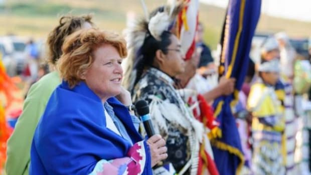 Heidi Heitkamp addresses the audience at the Fort Yates Powwow in July.