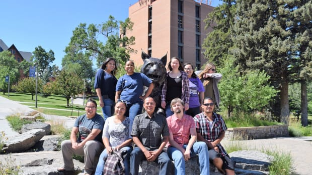 Some of the Native students at Montana State University pose with the university's mascot, the Bobcat.