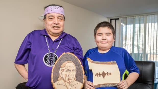 Mohawk artist Tracy Thomas and 12-year-old grandson Franklyn Williams display their art.