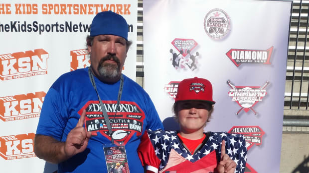 Winning Choctaw Punter and Sixth Grader Herbie Barber IV and his father Herbie Barber III (on left.)
