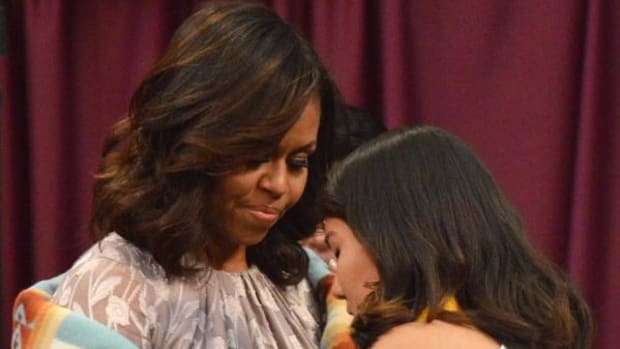 "Student presenter Fatima Garcia (Santo Domingo) presented First Lady Michelle Obama with a gift of thanks for ""protecting us as your own children."""