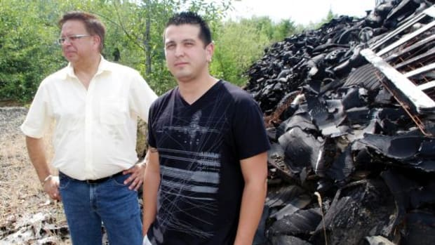 Tseshaht Councillor Hugh Braker, left, and tribe operations manager Ken Watts stand before one of many tire piles located in an abandoned tire dump one mile from tribal lands. The dump is a fire and environmental hazard and the tribe wants the provincial government to clean it up.