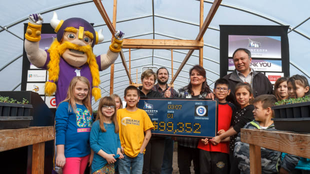 Super Bowl Host Committee - The Viking mascot of the Minnesota Viking's NFL football team joined in delivery of a $99,323 grant for the Mille Lacs Band of Ojibwe for Mino-Miijim program. Courtesy Steffenhagen Photography -