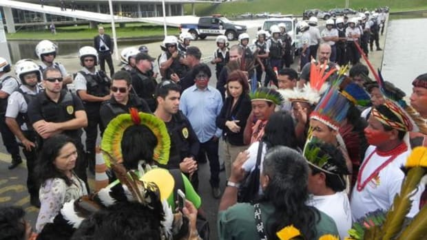 Indigenous protesters in Brazil try to enter congress on October 2 as part of the National Indigenous Mobilization organized to draw attention o legislation that threatens Native control over ancestral lands.