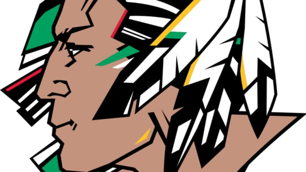 The University of North Dakota voted Wednesday to abandon its Native American mascot and moniker, but it was no easy feat.