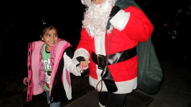 Santa Claus takes on many guises. Once he was even a Pueblo Indian woman! (Ahem. The author, with her niece, in 2009.)