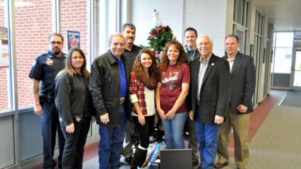 Pictured, from left, are Cherokee Nation Marshal Shannon Buhl, Community Resource Investigator Shawnna Roach, Deputy Chief S. Joe Crittenden, Sequoyah Schools Superintendent Leroy Qualls, Sequoyah sophomore Treanna Washington and mother Dawn, Tribal Councilor David Walkingstick, Principal Chief Bill John Baker and Athletic Director Marcus Crittenden.