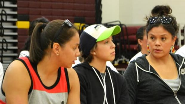 Shoni (left) and Jude Schimmel (center), sit with their mother, Ceci during an event.