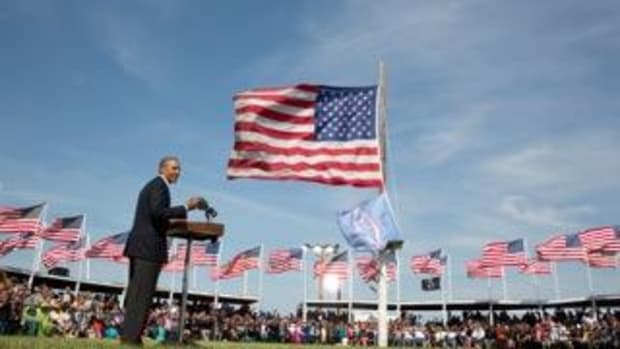 President Barack Obama and First Lady Michelle Obama attend the Cannon Ball Flag Day Powwow in Cannon Ball, North Dakota, June 13, 2014.