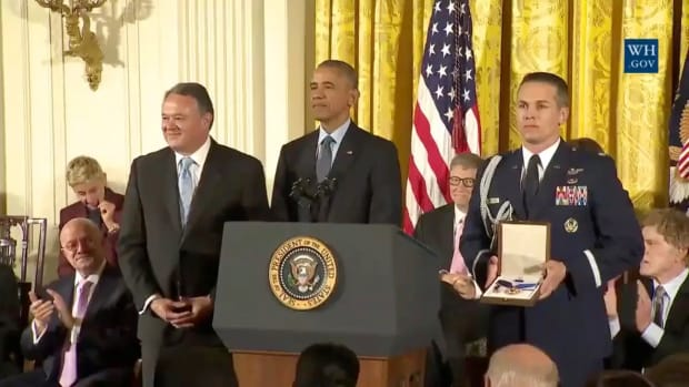 Turk Cobell accepts the Presidential Medal of Freedom in honor of his mother Elouise Cobell from President Obama.
