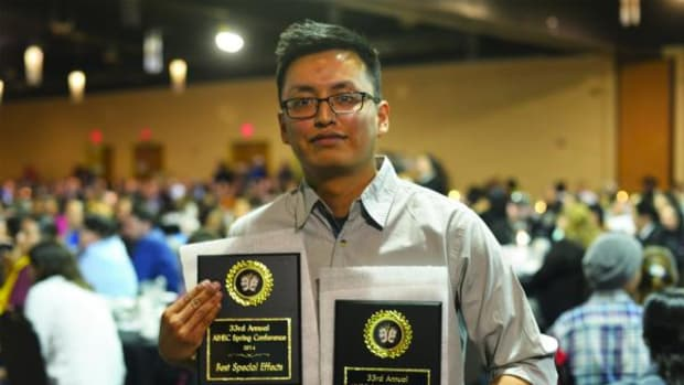 NTU new media major Clinton Desiderio of Crownpoint, New Mexico poses with his Best Special Effects award and Director's Award at the 33rd Annual AIHEC Spring Conference.