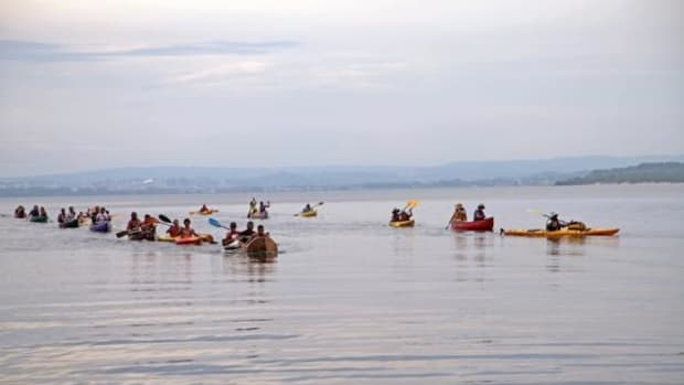 The Two Row Wampum Renewal Campaign paddlers finish their paddle across Onondaga Lake on July 2. Haudenosaunee paddlers are on the left and Neighbors of the Onondaga Nation paddlers are on the right.
