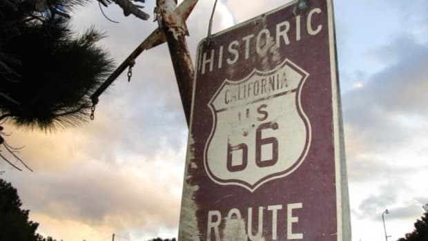 A faded Route 66 sign is shown in front of historic Summit Inn diner, located at the southern end of the Cajon Pass—the trail linking the desert with the California coast through San Bernardino.