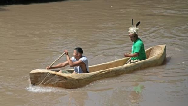 Hickory Edwards (back) and Pete Edwards (front), of Onondaga Nation, take the dugout canoe on its first trip on Onondaga Creek, Onondaga Nation Territory in New York.