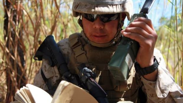 Lance Cpl. Tyler Slim, rifleman and radio operator, 1st Platoon, Lima Company, 3rd Battalion, 3rd Marine Regiment, Marine Rotational Force – Darwin, and a Tuba City, Ariz., native, calls in a radio check, here, May 8. Slim's grandfather, or Cheii, Navajo for grandfather, served as a code talker in the Marine Corps, a group of Native-American Marines who used the Navajo language to transmit secret tactical information using radios during war time. Hearing Cheii's stories of his time in the Corps played a part in Slim's decision to enlist.