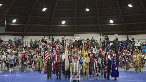 The colors are presented during grand entry of the 43rd Annual Diné College Powwow in Tsaile, Ariz., on Saturday night, April 13, 2013.