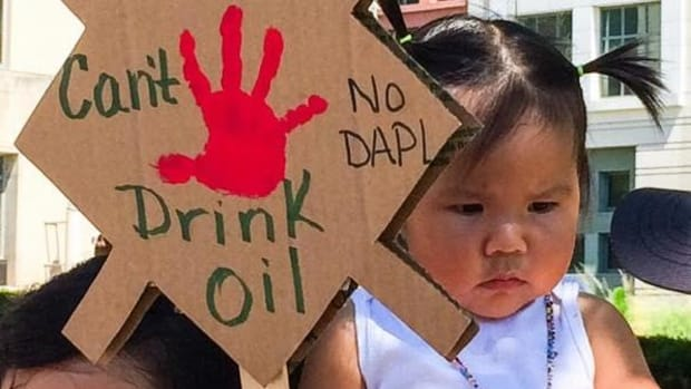 A youthful supporter of the campaign to stop the Dakota Access Pipeline.