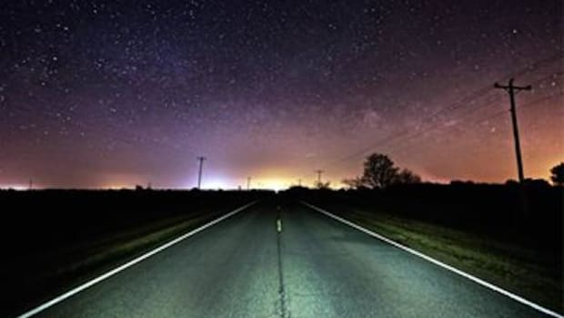 Road, a photograph of a lonely stretch of state Highway 81 and a starry sky near Hennessey, Oklahoma, attracted photographer Jim Trosper's attention. This photo and many more will be displayed in art shows in Oklahoma City and Tulsa in February.