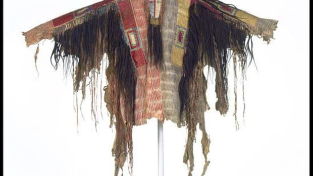 Man's shirt, probably Hunkpapa Lakota, ca. 1875. North Dakota. Deerhide, wool cloth, porcupine quills, human hair, pigments, dyes; 105 x 151 x 6 cm. Said to have been owned by a member of Sitting Bull's band; collected from the owner in 1890 by General William Passmore Carlin (1829–1903), commander at Fort Yates, North Dakota. NMAI 12/1.