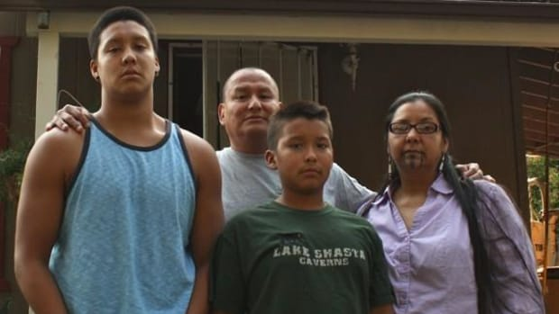 Sage Frank (left) with his little brother Bluestar Frank, his dad Cameron Frank and his mom April Carmelo outside their family home in the City of Shasta Lake. Sage was allegedly attacked by an apparent self-proclaimed white supremist.