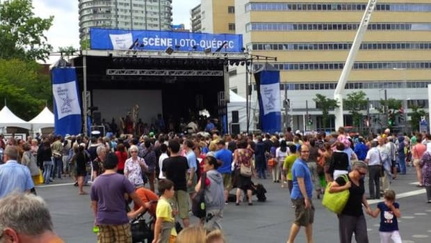 Attendees of the Montreal First Peoples Festival catch dancing and music at the Place des Festivals.