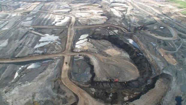A mine in the Alberta oil sands. The tailing ponds from these mines are leaking water into the Athabasca River, a new Canadian study says.