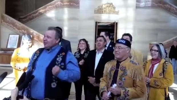 Manitoba Métis Federation President David Chartrand and Métis National Council President Clément Chartier speak on March 8, 2013, after Canada's highest court upheld their 146-year-old land claim.