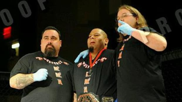 Shawn Bales, center, was a champion in the Cage of Honor Super Heavyweight division of XFI.