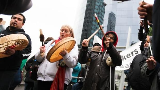 Indigenous protesters drummed and sang outside the Enbridge Northern Gateway hearings, which faced more than 1,000 protesters when it began hearings in Vancouver, British Columbia, on January 14, 2013.