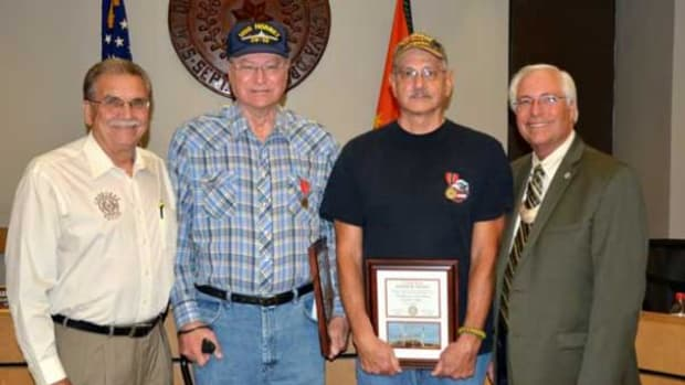 Cherokee Nation Deputy Chief S. Joe Crittenden thanked Cherokee veterans and brothers Elmer Tadpole Jr. and Thomas Tadpole for their service to the country, as Principal Chief Bill John Baker presented the brothers their Cherokee Nation veteran awards.