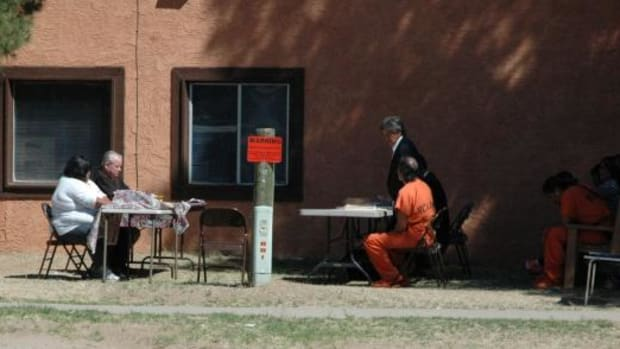"""Chief Tribal Judge Edd Dawson held court behind the Dennis Titla Sr. Justice Center on the San Carlos Apache Reservation. The building houses two courtrooms that were occupied, with cases piling up Dawson decided to give new meaning to """"open"""" court."""