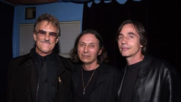 "Kris Kristofferson and Jackson Browne join John Trudell backstage after his concert to celebrate the release of his album ""Bone Days."" Angelina Jolie executive produced the album for Trudell."