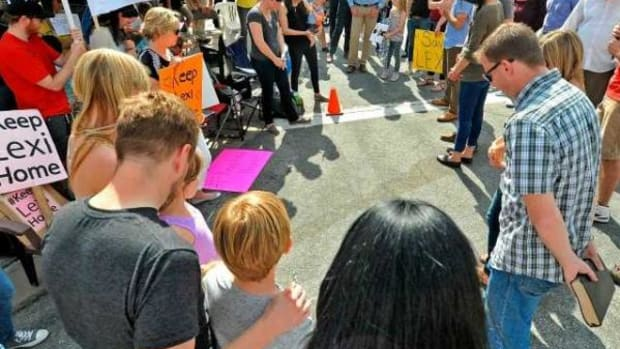 """Protestors gathered and prayed to """"Save Lexi"""" pray near the foster families home in California."""