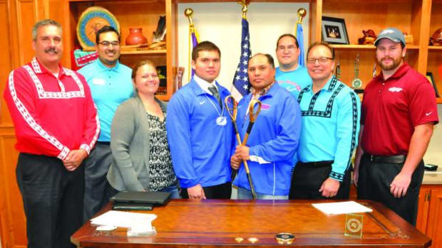 The Baker family (center: Allen with mom Tracy and dad Robert) with Assistant Chief Jack Austin Jr., Texoma Lacrosse Coach Mike Delloro, Tvshka Homma Coach Ryan Spring, St. Gregory's Coach Bryan Seaman and Chief Gary Batton.