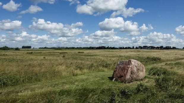 A buffalo rubbing stone sits amid the great expanse of 6,000 years of Northern Plains tribal history that is today known as Wanuskewin Heritage Park in Saskatchewan, Canada.