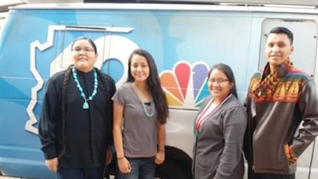 """(L to R) Kyle Blackhorse, Analicia Salas, Megan LaRose, and Jared Massey pose in front of a 12 News van after meeting with News Director Mark Casey at the Phoenix TV station to discuss use of the term """"R*dskins"""" during its newscasts."""