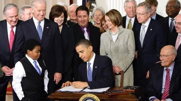 In this March 23, 2010 file photo, President Barack Obama signs the health care bill in the East Room of the White House in Washington. Health insurers flirted with Democrats, supported them with money and got what they wanted: a federal mandate that most Americans carry health care coverage. Now they're backing Republicans, hoping a GOP Congress will mean friendlier regulations.