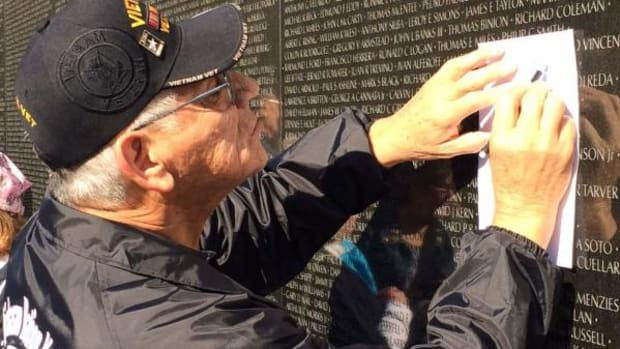 Chickasaw veteran Leonard Sealey discovers the name of a fallen friend at the Vietnam Veterans Memorial in Washington, D.C. Sealey and 15 other Chickasaw veterans from several states toured famed veteran sites throughout the nation's capital for five days during a trip sponsored by the Chickasaw Nation to thank them for their service.