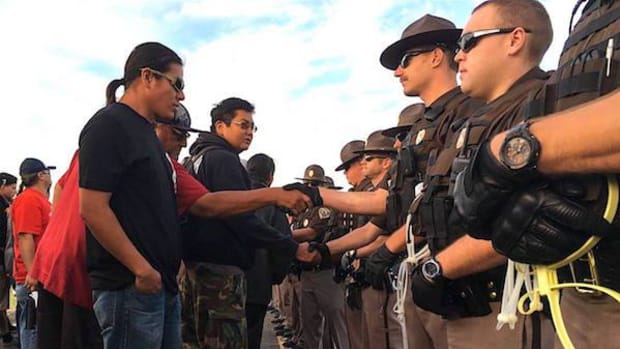 """Following initial arrests, water protectors and supporters continued to stress respectful relations with North Dakota law enforcement. """"These people are not our enemies, they are North Dakotans, too, and they drink the same water,"""" said John Eagle, SRST's historic preservation officer. """"They are here to protect all of us."""" Chairman Archambault, Keeper of the Pipe Arvol Looking Horse and representatives from 180 Indian nations are camped along the Cannonball River in prayer and unity to protect their water."""
