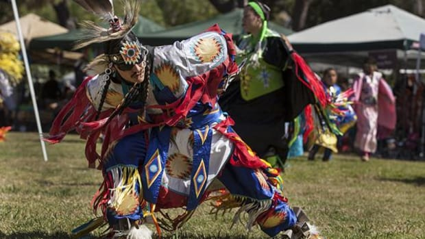 Standing Rock Sioux grass dancer Michael Cadotte dances during an inter-tribal, in Oceanside, Calif., on Saturday afternoon, June 14, 2014.