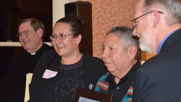 Left to right: Bishop Wells, Charlotte Nilson, Ernie Stensgar and Reverend Soeldner with Sierra Club with photo presented to the Coeur d'Alene Tribe by the Sierra Club.