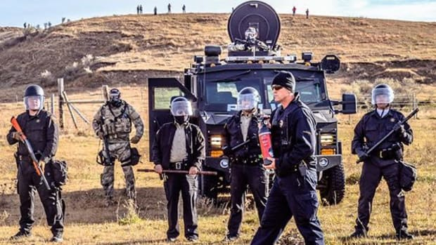 Police from seven states have been called in to launch a military operation against unarmed water protectors trying to reroute the Dakota Access Pipeline.