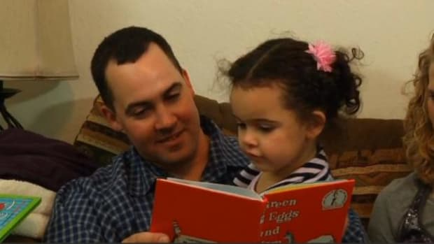 Dusten Brown reads a book to his daughter Veronica, then 3, at their home in Nowata, Oklahoma.