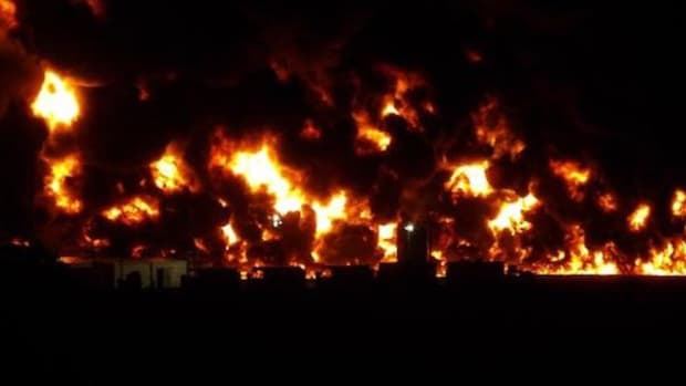 This fire exploded at and consumed three dozen storage tanks on a New Mexico oil field. An investigation and environmental assessment are under way.