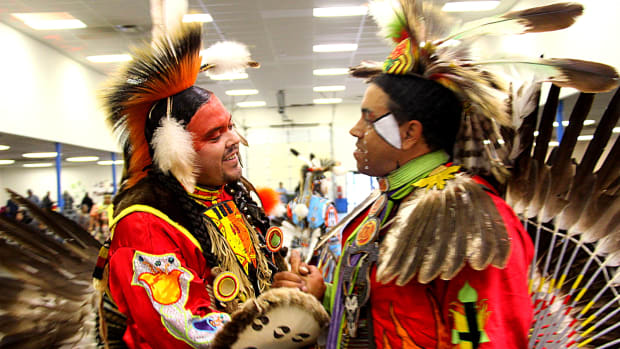 Pow Wow Planner - Two dancers share a handshake at the Richmond pow wow. Photo Vincent Schilling