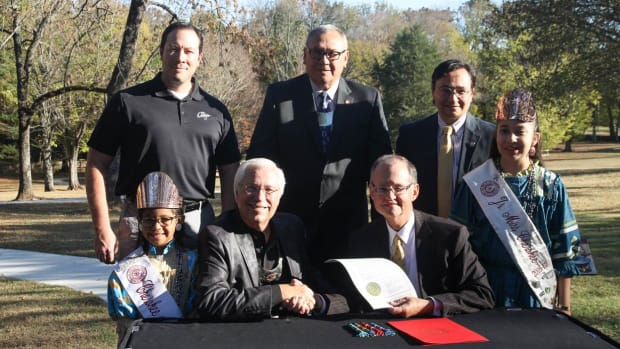The Cherokee Nation recently purchased Sequoyah's Cabin from the Oklahoma Historical Society. (Back Row) Bryan Warner, Cherokee Nation Tribal Councilor; Chuck Hoskin, Cherokee Nation Chief of Staff; Chuck Hoskin Jr., Cherokee Nation Secretary of State. (Front Row) Emma Fields, Little Miss Cherokee; Cherokee Nation Principal Chief Bill John Baker; Dr. Bob Blackburn, director of the Oklahoma Historical Society; and Lauryn McCoy, Junior Miss Cherokee.