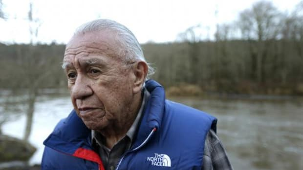Billy Frank Jr., a Nisqually tribal elder who was arrested dozens of times while trying to assert his native fishing rights during the 1960s and '70s, poses for a photo Monday, January 13, 2014, near Frank's Landing on the Nisqually River in Nisqually, Washington.