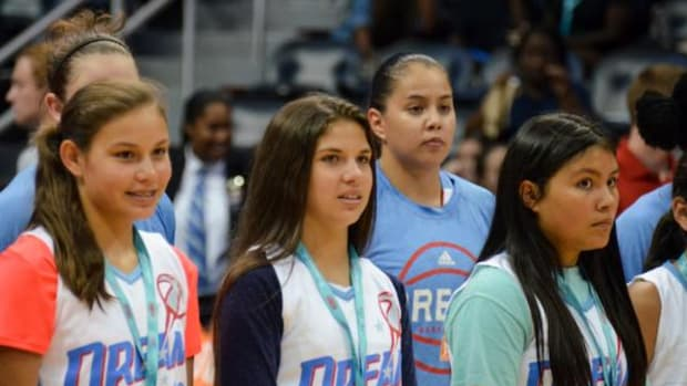 Shoni Schimmel joins the Eastern Band of Cherokee youth during the Atlanta Dream vs. Chicago Sky opening events on June 19 at the Native American Heritage night.