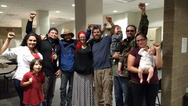 Line 3 water protectors, just released on bond in Douglas County, Wisconsin, hold their fists high on August 29, 2017.